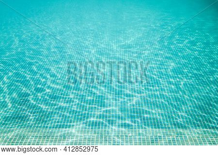 Beautiful Clear Pool Water Reflecting In The Sun. Clear Water In The Pool With A Shine From The Rays