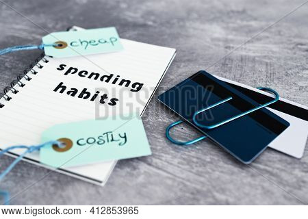 Spending Habits Text On Notepad With Payment Cards And Cheap Vs Costly Prioduct Price Tags Next To I
