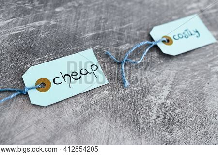 Cheap Vs Costly Prioduct Price Tags Next To Each Other Symbol Of Options For The Customer, Money And