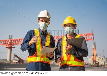 Two Engineer Worker Tablet Working On Site Road Construction, Asian Man Architecture Builder Buildin