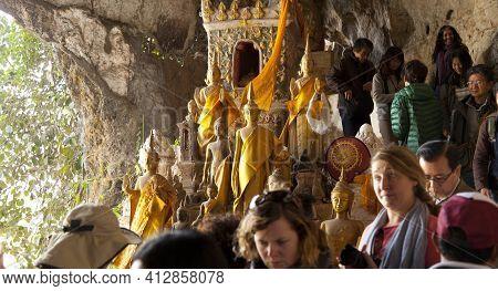 Luang Prabang - Dec 30,2016 : Crowd Of Tourists Walking In Pak Ou Caves On Mekong River On December