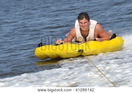 Teenage Tuber Sliding Across the Wake