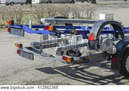 New Boat Trailers For Sale. Rear Of Vehicles With Reflectors. Outdoors. City Traffic In The Backgrou