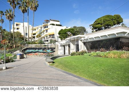 LAGUNA BEACH, CALIFORNIA - JANUARY 6, 2017: Lifeguard Headquarters with the Inn at Laguna Beach on the hillside above.