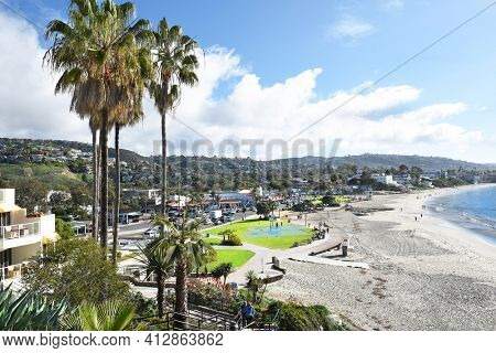 LAGUNA BEACH, CALIFORNIA - JANUARY 6, 2017: Main Beach from the bluffs. Volleyball courts, basketball courts, and grass expanse line the popular coastline.