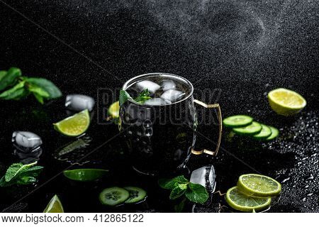 Moscow Mule Cocktail With Lime, Mint And Cucumber. Alcoholic Cocktail In Copper Mugs, Freeze Motion