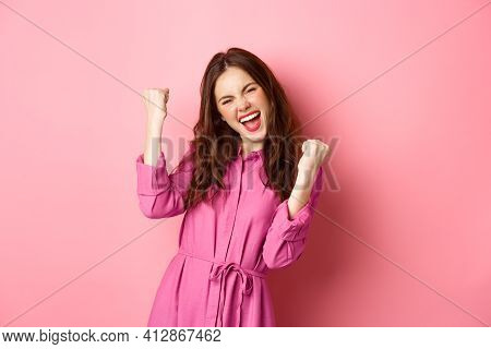 Beautiful Smiling Woman Scream With Happy And Excited Face, Saying Yes, Making Fist Pump, Winning An