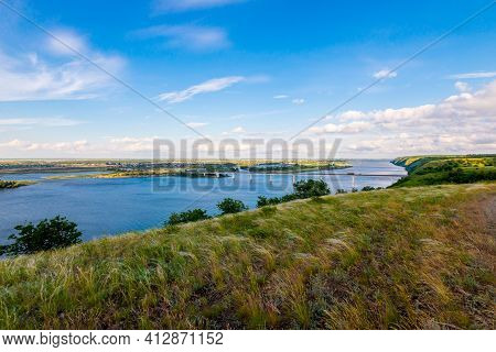Panoramic View Of The Road Bridge Over Big River And Hills, Slopes, Steppe Coast, Gully, Ravine On A