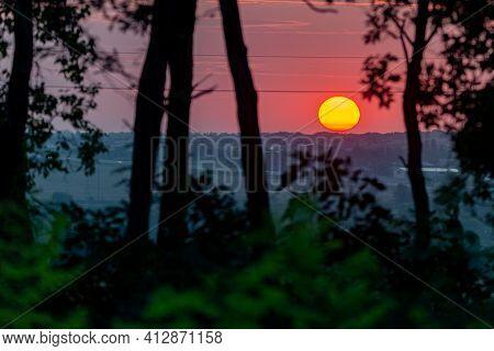 Dark Sunset With Bright Orange At Horizontal Purple Sunset Sky And Field Silhouette Stock Sunset Fie
