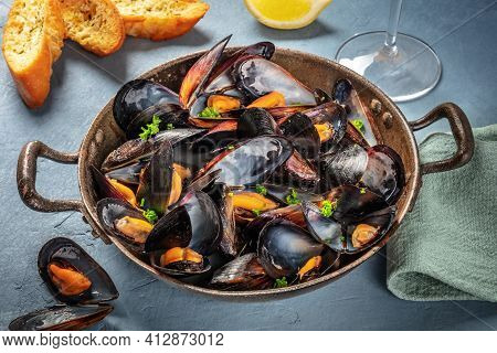 Fresh Mussels In A Pan, With Parsley And Lemon