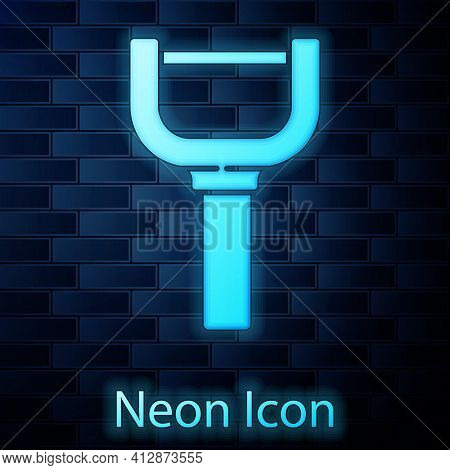 Glowing Neon Peeler Icon Isolated On Brick Wall Background. Knife For Cleaning Of Vegetables. Kitche