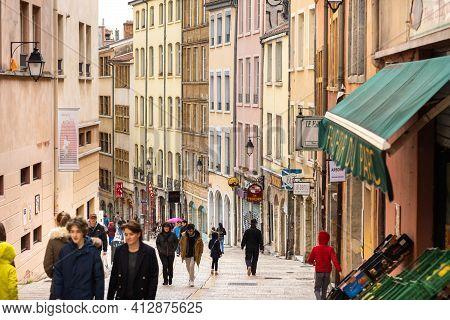 Lyon, France, April 7, 2019: People Walk Along A Narrow Street In The Historic Center Of Lyon, Franc