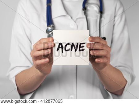 Acne Word, Inscription On Paper In Doctor Hands, Medical Dermatology Problem With Skin