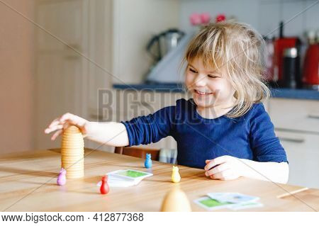 Adorable Cute Toddler Girl Playing Parlor Game. Happy Healthy Child Training Memory, Thinking. Creat
