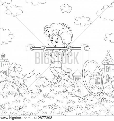 Cheerful Little Boy In Light And Sport Clothes Pulling Himself Up On A Sport Horizontal Bar On A Pla