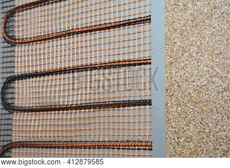 A Close-up Of An Electric Radiant Wall Heater. Electric Radiant Heating System Maintenance.