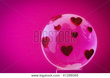 The planet of love. Glass globe with red hearts. Concept of Valentines day. poster