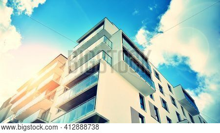 Apartment Residential House And Home Facade Architecture And Outdoor Facilities. Blue Sky On The Bac