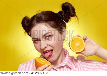A Girl In Her Thirties, Close-up, On A Yellow Background With An Orange. The Concept Of Cosmetology.