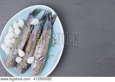 Dutch Herring. Traditional Dutch Food, Marinated Fish Fillet With Onion And Lemon. Food High In Nutr