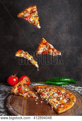 Side View Pizza With Pepper And Tomato And Pizza Slices In Board Cookware On Stone Background
