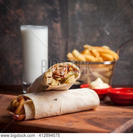 Side View Shawarma With Fried Potatoes And Ayran And Mayonnaise In Board Cookware On Stone Backgroun