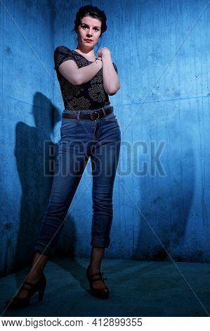 Beautiful Dancer Posing In A Blue Corner Indoors