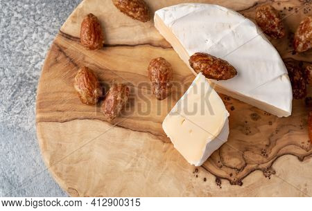 Brie Type Of Cheese. Camembert Cheese. Fresh Brie Cheese And A Slice On A Wooden Board With Sweet Al
