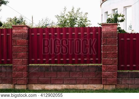 Vertical Fence Section Made Of Metal Profile Pickets And Brick Block Pillars. Territory Landscaping.
