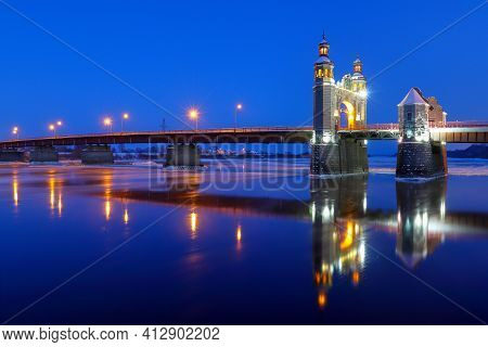 The Arch Of The Queen Louise Bridge Along With Illumination And Lanterns Is Reflected In The Night N