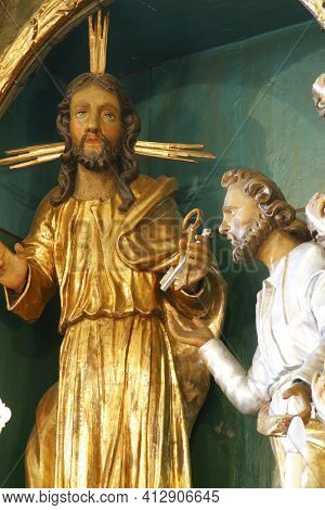 SVETI PETAR MREZNICKI, CROATIA - JULY 14, 2013: Jesus gives the keys to St. Peter, a statue on the high altar in St. Peter's Parish Church in Sveti Petar Mreznicki, Croatia