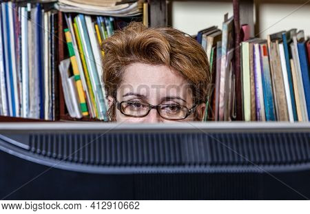 Portrait Of A Busy Woman Telecommuting At Her Desk At The Home. Working At Home Became An Important