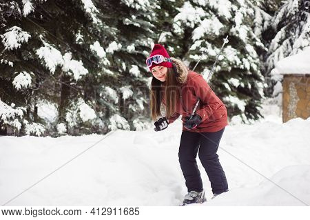Woman Skiing In The Winter Forest. Inexperienced Skier Skiing Training. Young Caucasian Woman Skier