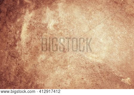 Textured Rust Stucco Background With Scratches, Scuffs And Stains. Grungy Backdrop Of Ginger Color F