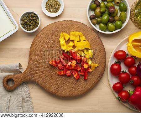 Vegetarian Food. Chopping Pepper, Cutting Vegetables For Greek Salad Horiatiki. Wooden Cutting Board
