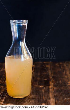 Homemade Kombucha Is A Fermented, Probiotic, Organic Beverage. Rustic Dark Wood Background, Copy Spa