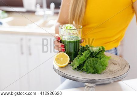 Green Detox Smoothie With Vegetables On The Table In The Kitchen. Healthy Drink, Detox, Diet