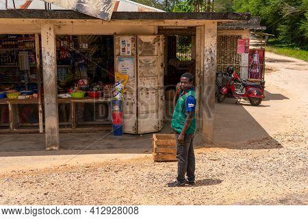 Zanzibar, Tanzania - January 2020: Black African People Vendors At The Street Fruit And Goods Shop S