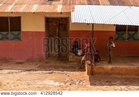 Zanzibar, Tanzania - January 2020: Group Of Black African People In Their Usual Lifestyle On Streets