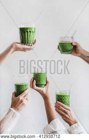 Glasses Of Detox Healthy Green Smoothie In Hands