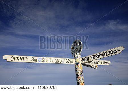 John O'groats (scotland), Uk - August 04, 2018: Multi Directional Signpost At John O'groats Area, Ca