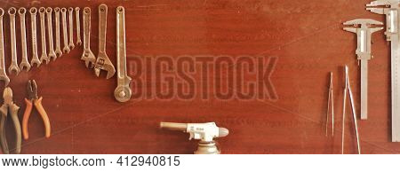 Tool Kit Board For Carpenter Or Locksmith In Workshop With Copy Space In The Center, Various Wrenche