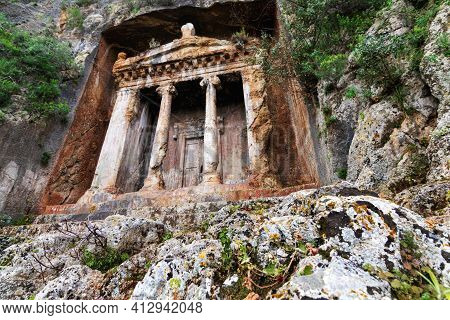 Lycian Tombs In The Turkish City Of Fethiye. The Tombs Of Amintas Carved Into The Rock Rise Above Th