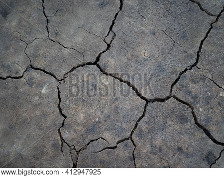 Surface Of A Grungy Dry Cracking Parched Earth For Textural Background