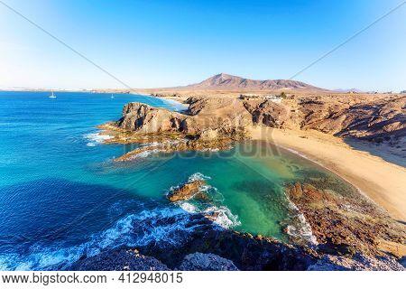 Playa De Papagayo Beach, Desert Landscape And Blue Sky. Lanzarote. High Quality Photo