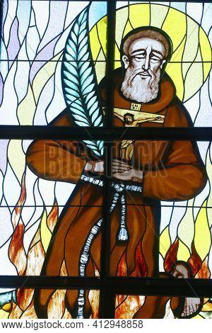 OSTARIJE, CROATIA - JULY 14, 2013: St. Nicholas Tavelic, stained glass window at Our Lady of Miracles Parish Church in Ostarije in Croatia