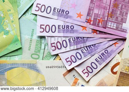 Euro Currency Banknotes Background. European Paper Money Backdrop With 100, 200 And 500 Euros Bills.