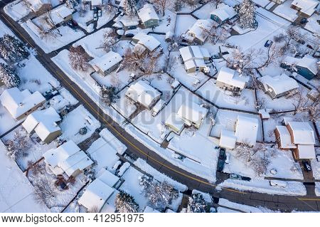 street in a residential area of Fort Collins in northern Colorado after heavy snowstorm, aerial view of late winter or erly spring scenery