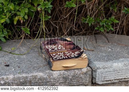 Jerusalem, Israel, February 27, 2021 : Evening View Of The An Old Shabby Book Lies On The Curb On Ze