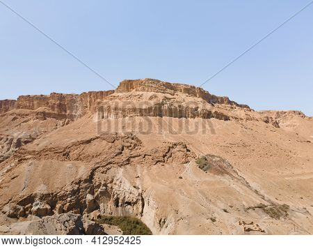 A Sandy Mountain That Used To Be The Bottom Of The Dead Sea Stands Near The Ein Bokek Embankment On